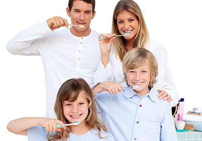 happy family brushing their teeth